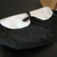 Til salg: Sort/hvid kravetaske